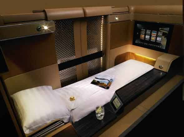 etihad-sports-a-luxurious-flatbed-seat-in-each-of-its-suites-which-at-the-touch-of-a-button-shifts-into-a-6-8-bed