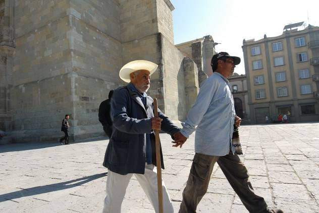 Assisting_blind_man_walking_mexico-e1372307750841