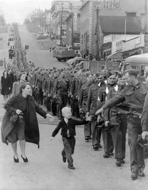 33 Child runs for his father as they leave for WW2
