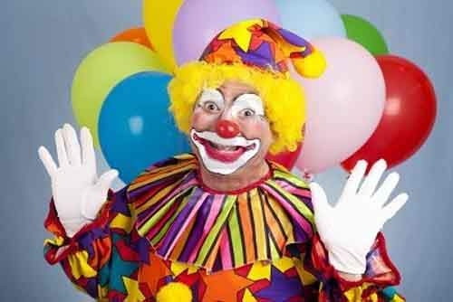 6713363-happy-birthday-clown-with-balloons-holding-his-hands-in-a-surprised-gesture