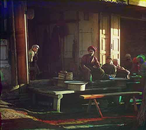 a-group-of-men-eat-at-an-open-air-restaurant-in-modern-day-samarkand-uzbekistan