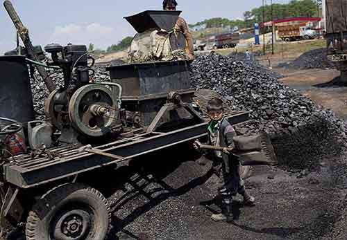 tens-of-thousands-of-children-are-employed-in-its-illegal-coal-mines