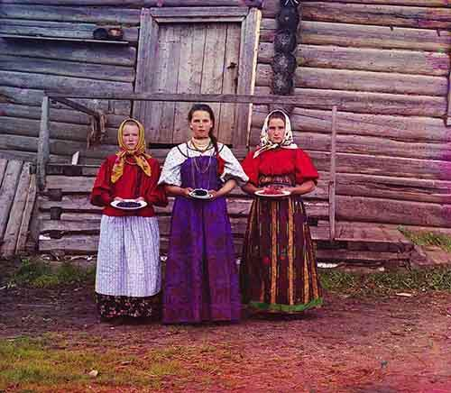 three-young-women-offer-berries-to-visitors-to-their-izba-a-traditional-wooden-house-in-a-rural-area-along-the-sheksna-river-near-the-town-of-kirillov