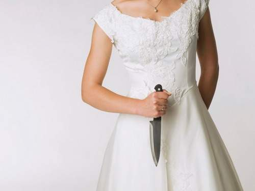 Bride holding knife, mid section