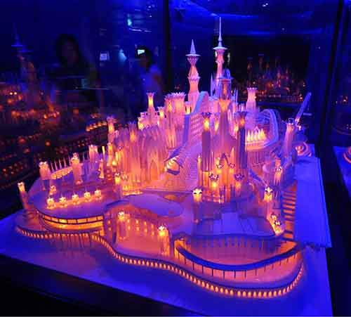 A beautifully lit castle made entirely out of paper
