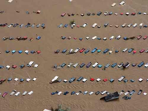 a-field-of-parked-cars-and-trucks-sits-partially-submerged-near-greeley-colo-in-september-after-floods-destroyed-an-area-the-size-of-connecticut