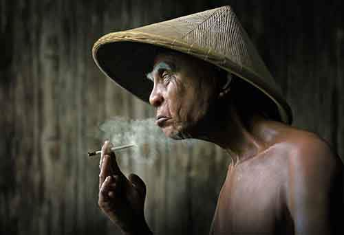 a-vietnamese-man-smokes-his-cigarette
