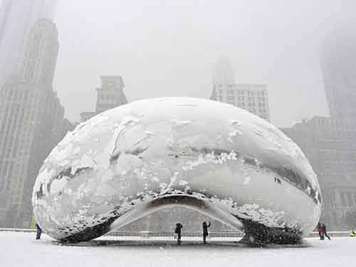 chicago-monument-cloud-gate-better-known-as-the-bean-wore-a-layer-of-ice-as-a-major-blizzard-dropped-just-under-10-inches-of-snow-on-chicago-in-march