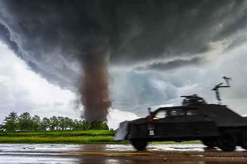 some-stormchasers-use-a-tornado-intercept-vehicle-pictured-to-film-from-the-center-of-a-tornado-hollingshead-uses-a-standard-mitsubishi-eclipse