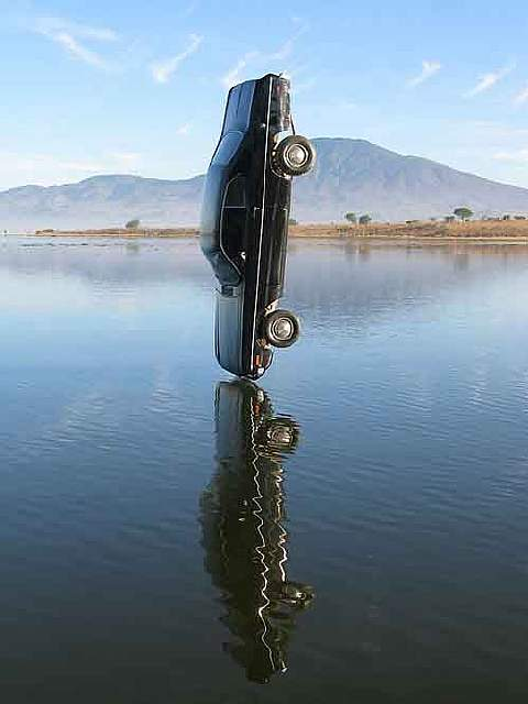 Still image of a car the moment before being dropped into the water.