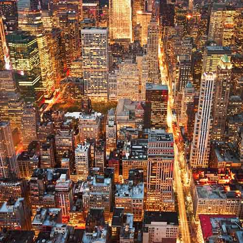buildings-in-new-york-city-at-night-as-seen-from-the-empire-state-building