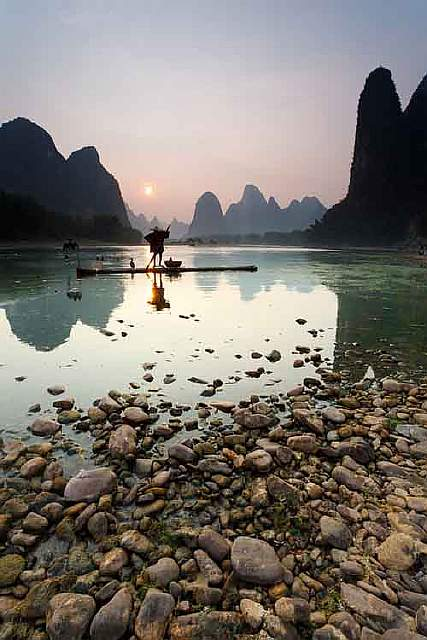 chinas-li-river-is-known-for-its-jagged-limestone-peaks-bubbling-streams-water-buffalo-and-cormorant-fishing