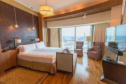 on-the-other-side-of-the-room-is-the-bed-with-a-flat-screen-tv