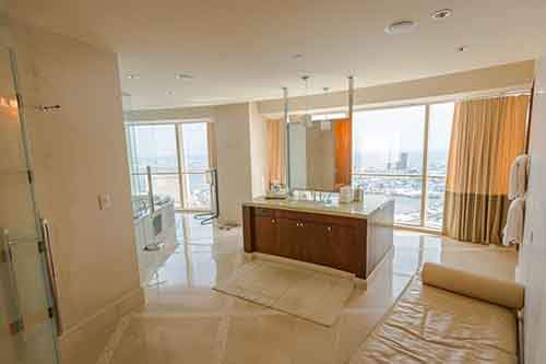 the-bathroom-of-the-master-bedroom-is-equally-large-with-an-island-sink-station-in-the-center-of-the-room