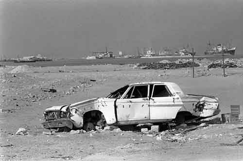 then-a-discarded-plymouth-convertible-american-car-is-seen-on-the-outskirts-of-the-city-in-1977-where-it-was-dumped-in-the-desert