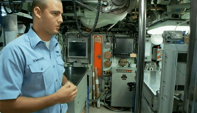 close-to-the-comm-area-is-the-navigation-section-of-the-submarine-where-the-quarter-master-keeps-watch