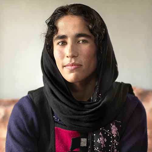 khotera-is-a-high-school-student-who-studies-the-quran-on-her-laptop-her-favorite-place-is-her-familys-living-room-where-she-watches-afghan-star-similar-to-american-idol