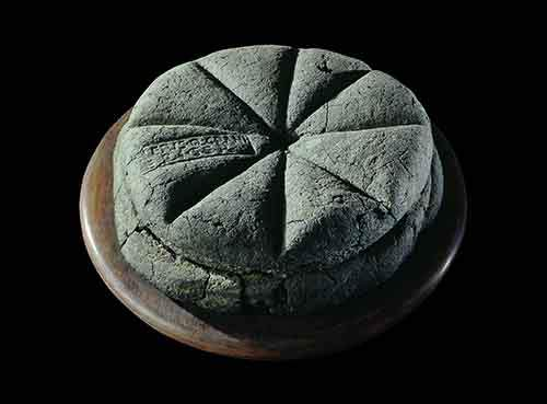A carbonised loaf of bread from Pompeii
