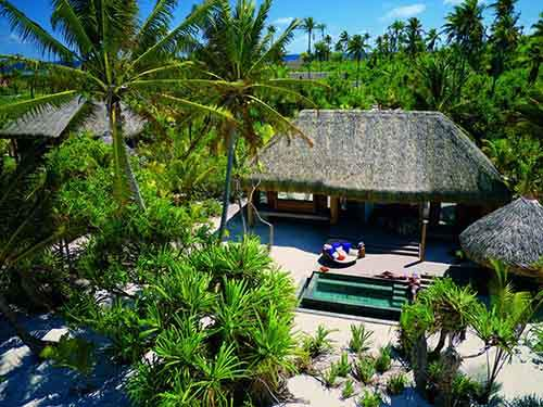 each-villa-is-located-on-the-beach-and-has-its-own-outdoor-eating-and-private-beach-area