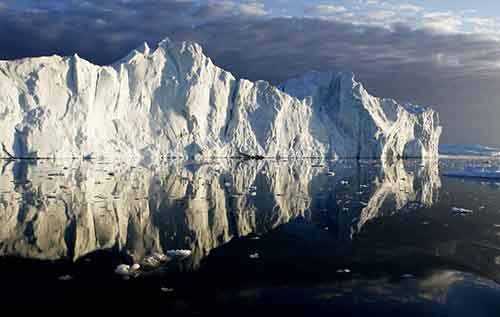 icebergs-are-reflected-in-the-calm-waters-at-the-mouth-of-the-jakobshavn-ice-fjord-on-the-west-coast-of-greenland