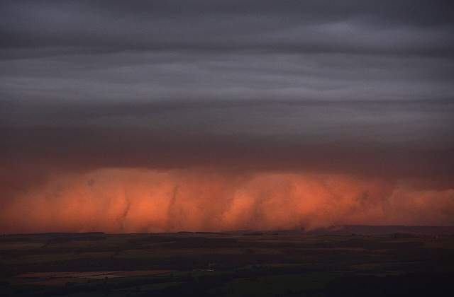 rain-clouds-are-lit-by-the-setting-sun-in-northern-england