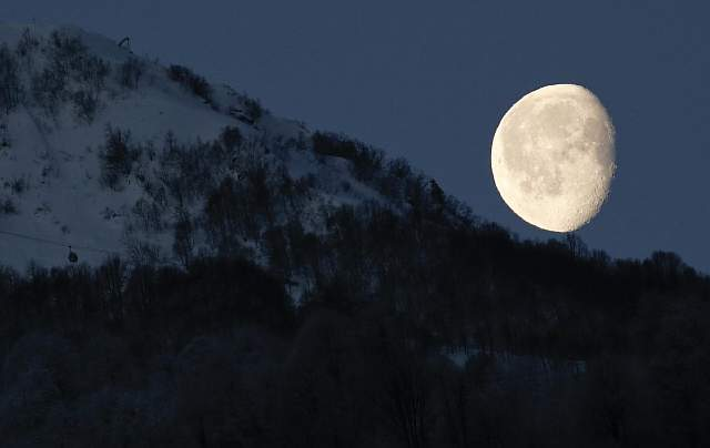 the-moon-is-pictured-above-the-mountains-in-rosa-khutor-in-russia-during-the-2014-sochi-olympics