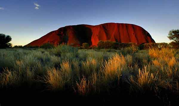the-sun-sets-on-ayers-rock-one-of-australias-major-tourist-destinations-attracting-400000-visitors-every-year