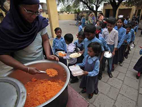 jammu-india-children-stand-in-line-to-receive-a-free-mid-day-meal-made-of-sweetened-rice-at-a-government-school