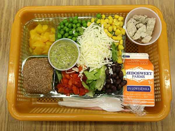 seattle-us-another-lunch-option-at-the-same-school-is-a-salad-with-low-sodium-chicken-a-whole-grain-roll-fresh-red-peppers-peas-corn-and-beans-with-cilantro-dressing
