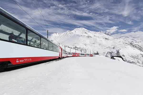 the-glacier-express-takes-passengers-across-80-miles-in-the-swiss-alps-at-an-altitude-of-6670-feet
