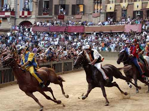 cheer-on-the-riders-at-the-palio-di-siena-bareback-horse-race-which-takes-place-in-siena-twice-each-year-on-july-2nd-and-august-16th