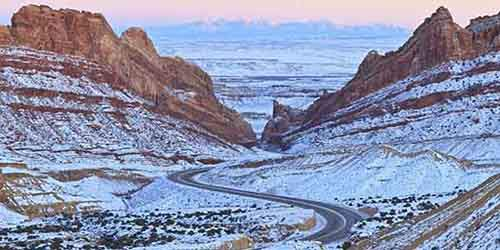 the-interstate-70-which-runs-through-utah-is-most-beautiful-in-winter-especially-when-it-winds-its-way-through-the-snow-covered-spotted-wolf-canyon