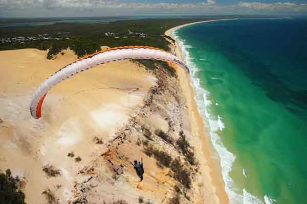 Riding-the-wind-at-Rainbow-Beach-Queensland-AU-690x460