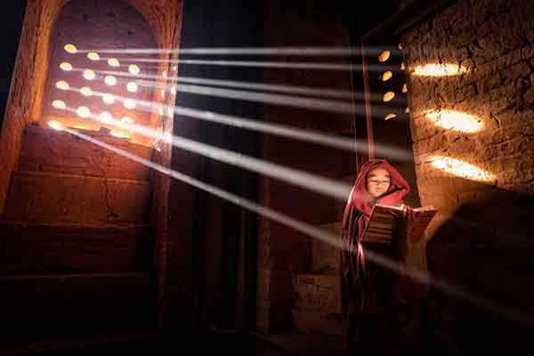 merit-prize-a-young-monk-finds-the-perfect-light-source-to-read-his-book-inside-his-pagoda-in-old-bagan-burma