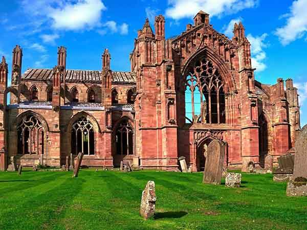 melrose-abbey-is-one-of-the-oldest-abbeys-in-scotland-today-you-can-explore-the-ruins-of-the-cistercian-abbey-which-was-damaged-in-the-1500s