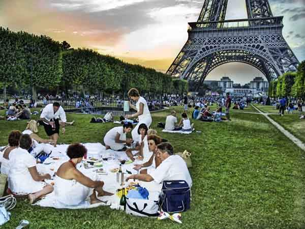 pick-up-a-fresh-baguette-some-stinky-cheese-and-a-bottle-of-wine-and-picnic-under-the-eiffel-tower-in-the-champ-de-mars
