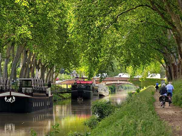 take-a-boat-along-the-canal-du-midi-a-unesco-world-heritage-site-that-runs-from-toulouse-to-the-mediterranean