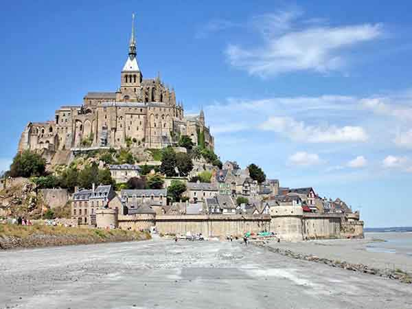 walk-along-the-mud-flats-of-mont-saint-michel-bay-during-low-tide-and-admire-the-gorgeous-benedictine-abbey
