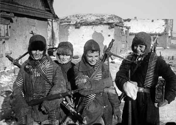 Young Russian boys find abandoned German weapons to play with after the Battle of Stalingrad