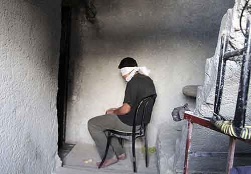a-blindfolded-man-waits-to-be-interrogated-by-free-syrian-army-in-aleppo-on-october-6-he-was-suspected-of-giving-information-to-the-syrian-government