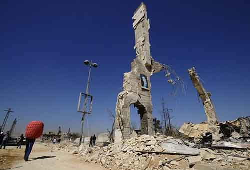 a-photo-of-syrian-president-bashar-al-assad-is-displayed-on-a-ruined-structure-in-damascus-the-country-has-now-been-in-civil-war-for-35-years
