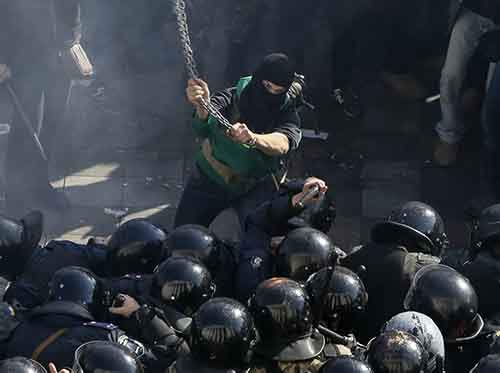 a-protester-battles-with-police-in-kiev-ukraine-on-october-14