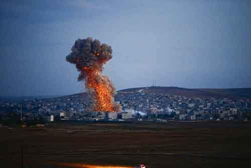a-smoke-cloud-rises-in-kobani-syria-after-an-airstrike-on-october-18
