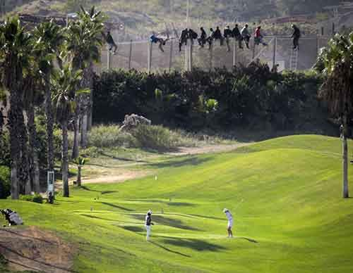 african-migrants-try-to-cross-the-border-into-spanish-territory-on-october-22-meanwhile-this-guy-golfs