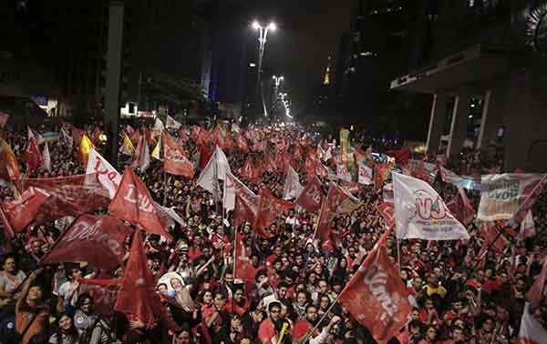 in-sao-paolo-supporters-of-brazils-president-and-workers-party-pt-presidential-candidate-dilma-rousseff-react-to-the-news-of-her-re-election-on-october-26