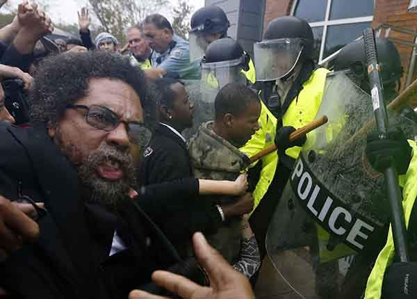 philosopher-activist-cornel-west-struggles-with-police-during-a-protest-in-ferguson-missouri-on-october-13
