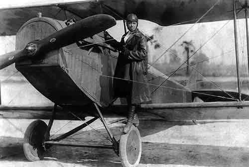 Bessie_Coleman_and_her_plane_19221