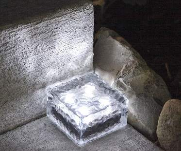 solar-powered-brick-lights-glass