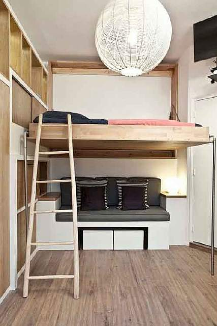 14915010-R3L8T8D-650-globe-chandelier-and-built-in-shelves-and-kid-bedroom-storage-ideas-also-space-saving-bunk-beds-with-ladder-and-hardwood-flooring