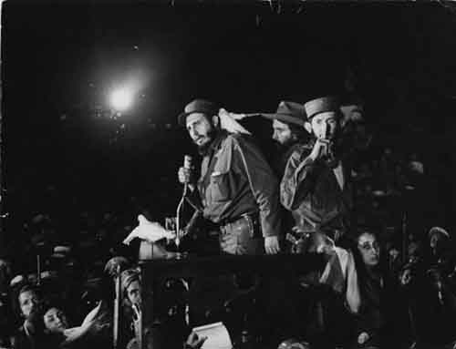 1959.-A-dove-landing-on-Fidel-Castros-shoulder-during-an-important-speech.-This-landing-has-been-the-subject-of-much-speculation-controversy-and-worship.-January-8-1959